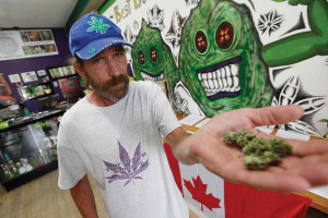 Glenn Price shows his personal medical cannabis is his new store in Winnipeg